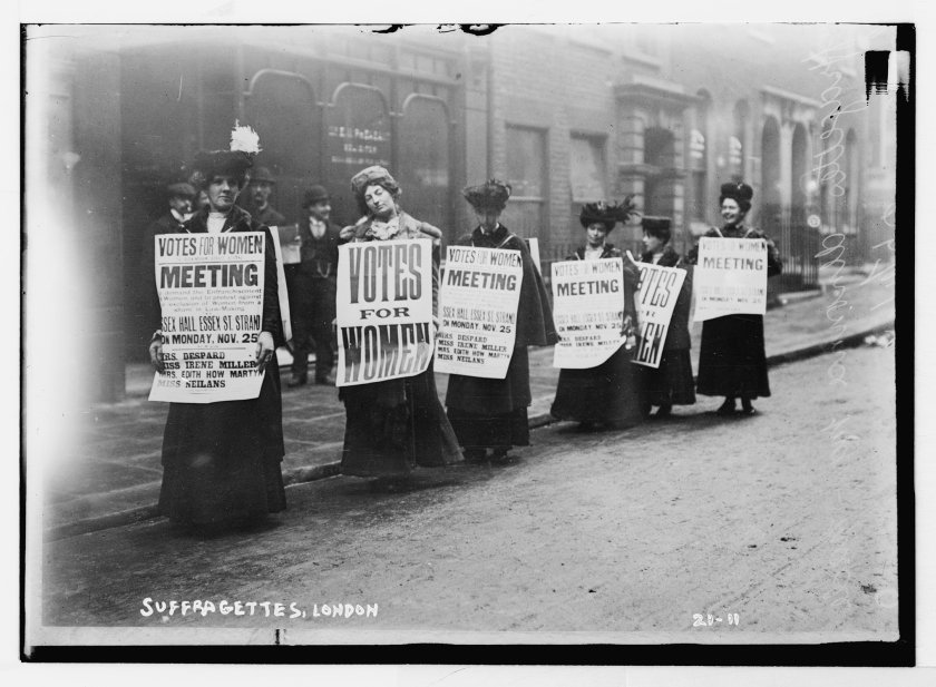 Suffragette with posters demanding votes for women, London, undated. Source: Library of Congress.